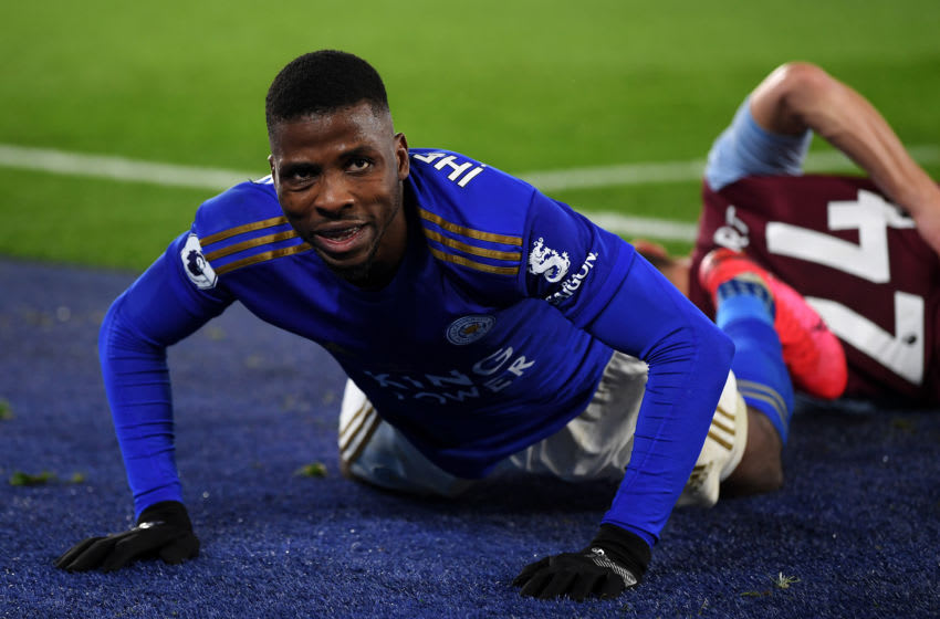LEICESTER, ENGLAND - MARCH 09: Kelechi Iheanacho of Leicester City falls to the ground after he battles for the ball with Frederic Guilbert of Aston Villa during the Premier League match between Leicester City and Aston Villa at The King Power Stadium on March 09, 2020 in Leicester, United Kingdom. (Photo by Michael Regan/Getty Images)