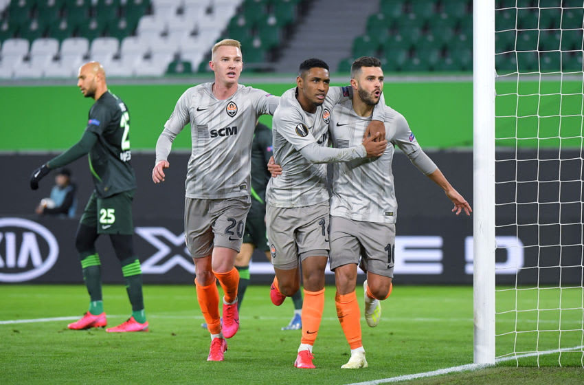 WOLFSBURG, GERMANY - MARCH 12: (FREE FOR EDITORIAL USE) In this handout image provided by VfL Wolfsburg, Junior Moraes of Shakhtar Donetsk celebrates with Tete and Viktor Kovalenko after scoring his team's first goal during the UEFA Europa League round of 16 first leg match between VfL Wolfsburg and Shakhtar Donetsk at Volkswagen Arena on March 12, 2020 in Wolfsburg, Germany. The match was played behind closed doors as a precaution against the spread of COVID-19 (Coronavirus). (Photo by Handout/VfL Wolfsburg via Getty Images)