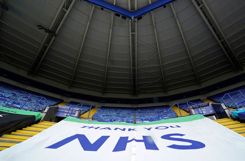 An NHS banner, Leicester City (Photo by TIM KEETON/POOL/AFP via Getty Images)