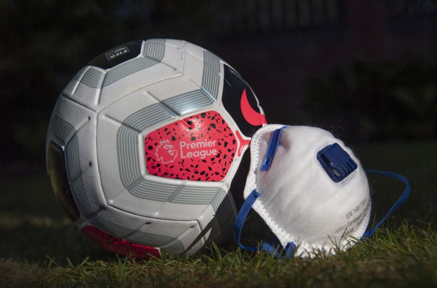 Premier League ball with face mask (Photo by Visionhaus)