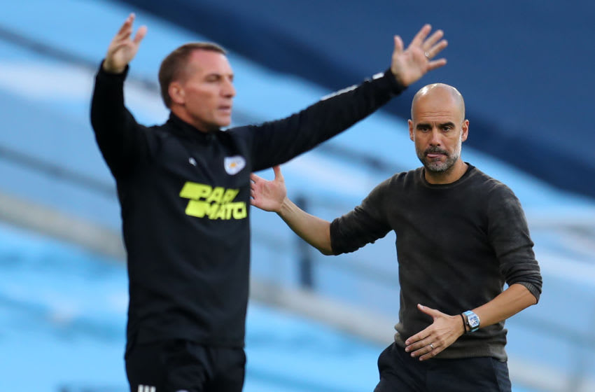 Leicester City's Brendan Rodgers (L) Manchester City's Pep Guardiola (Photo by CATHERINE IVILL/POOL/AFP via Getty Images)