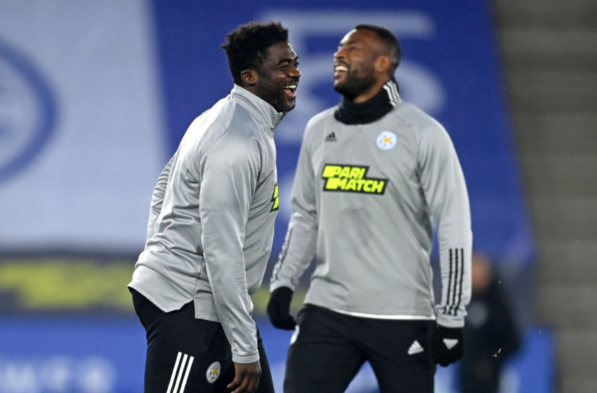 Leicester City's first team coach Kolo Toure (L) and Leicester City's English-born Jamaican defender Wes Morgan (R) (Photo by MICHAEL REGAN/POOL/AFP via Getty Images)