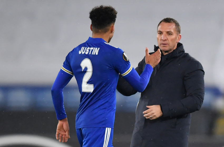 Leicester City's Brendan Rodgers (R), James Justin (L) (Photo by BEN STANSALL/AFP via Getty Images)