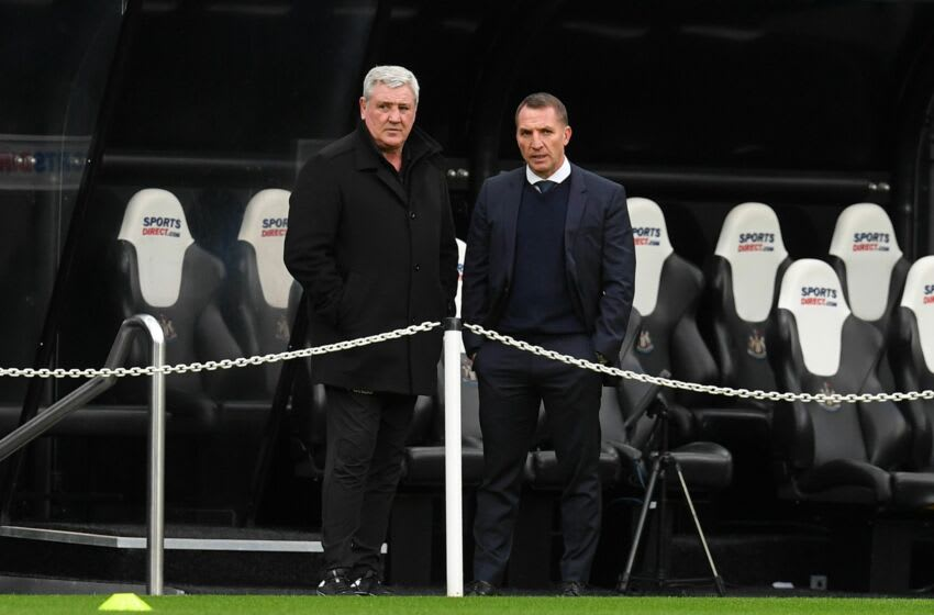 Newcastle United's English head coach Steve Bruce (L) and Leicester City's Northern Irish manager Brendan Rodgers (R) (Photo by PAUL ELLIS/POOL/AFP via Getty Images)