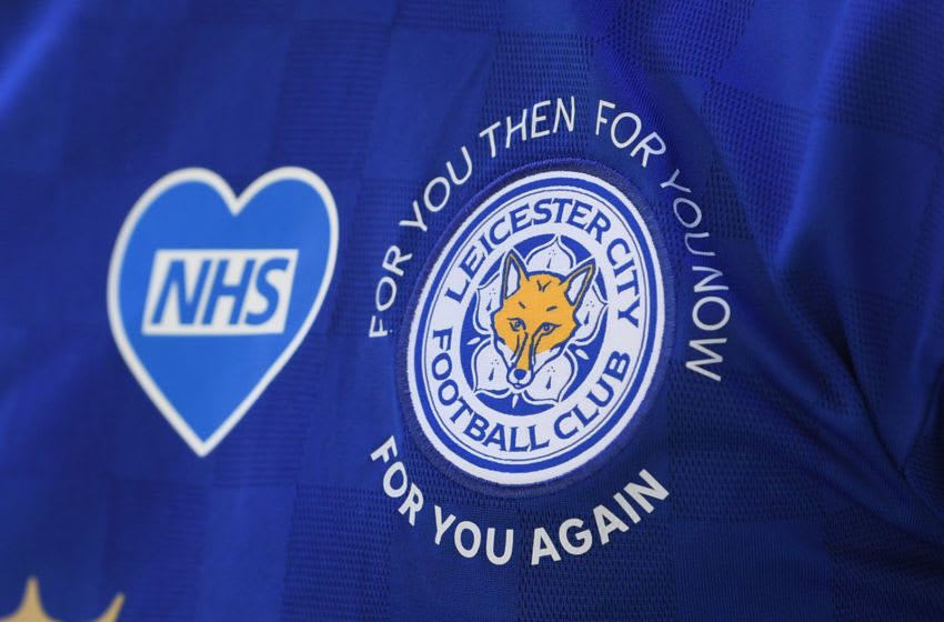 NHS logo and Leicester City badge (Photo by Michael Regan/Getty Images)