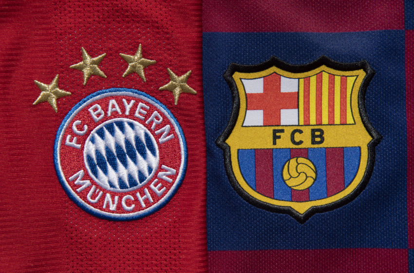 FC Bayern Munich and FC Barcelona club crests (Photo by Visionhaus)