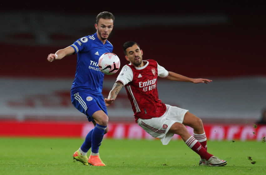 James Maddison of Leicester City battles for possession with Dani Ceballos of Arsenal (Photo by Catherine Ivill/Getty Images)