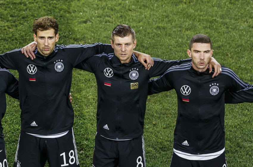 From left to right, Leon Goretzka, Toni Kroos and Robin Gosens of Germany (Photo by Mika Volkmann/Getty Images)