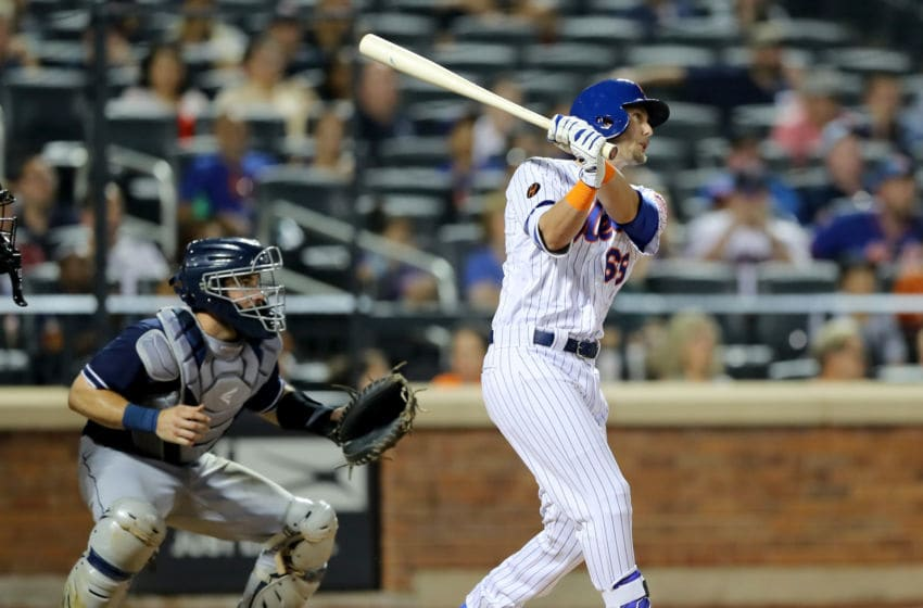 NEW YORK, NY - JULY 24: Jeff McNeil #68 of the New York Mets gets his first major league hit in his first major league at bat in the eighth inning as Austin Hedges #18 of the San Diego Padres defends on July 24, 2018 at Citi Field in the Flushing neighborhood of the Queens borough of New York City. (Photo by Elsa/Getty Images)