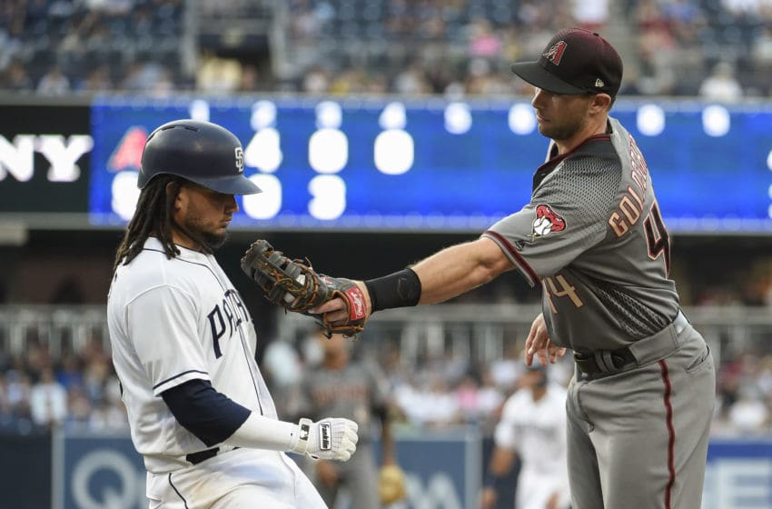 SAN DIEGO, CA - JULY 28: Paul Goldschmidt #44 of the Arizona Diamondbacks tags Freddy Galvis #13 of the San Diego Padres out at first base during the fourth inning of a baseball game PETCO Park on July 28, 2018 in San Diego, California. (Photo by Denis Poroy/Getty Images)