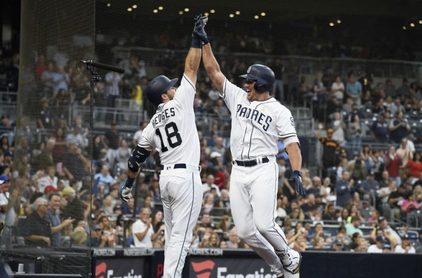 SAN DIEGO, CA - SEPTEMBER 1: Hunter Renfroe #10 of the San Diego Padres, right, is congratulated by Austin Hedges #18 after hitting a solo home run during the fourth inning of a baseball game against the Colorado Rockies at PETCO Park on September 1, 2018 in San Diego, California. The home was the second of the game for Renfroe. (Photo by Denis Poroy/Getty Images)