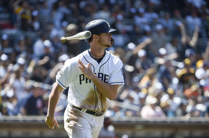 SAN DIEGO, CA - MARCH 28: Wil Myers #4 of the San Diego Padres hits a solo home run during the third inning on Opening Day against the San Francisco Giants at Petco Park March 28, 2019 in San Diego, California. (Photo by Denis Poroy/Getty Images)