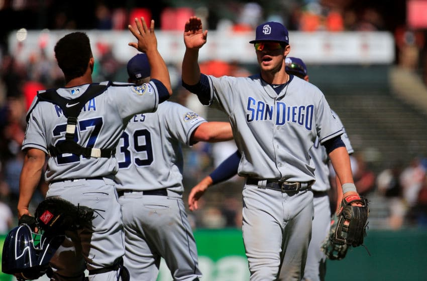SAN FRANCISCO, CALIFORNIA - APRIL 10: Wil Myers #4 celebrates with Francisco Mejia #27 of the San Diego Padres after beating the San Francisco Giants at Oracle Park on April 10, 2019 in San Francisco, California. (Photo by Daniel Shirey/Getty Images)