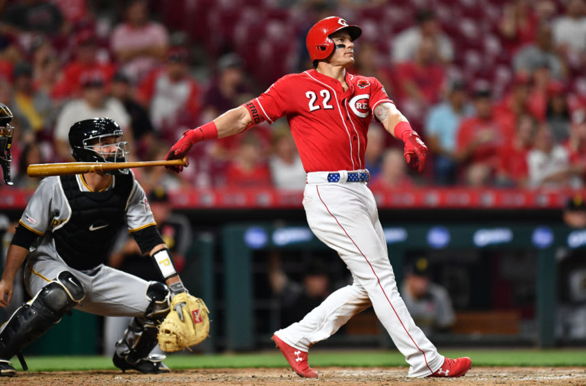 CINCINNATI, OH - MAY 27: Derek Dietrich #22 of the Cincinnati Reds watches his home run in the seventh inning against the Pittsburgh Pirates at Great American Ball Park on May 27, 2019 in Cincinnati, Ohio. Cincinnati defeated Pittsburgh 8-1. (Photo by Jamie Sabau/Getty Images)
