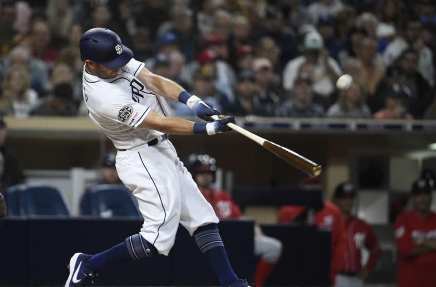 SAN DIEGO, CA - JUNE 8: Ian Kinsler #3 of the San Diego Padres hits a double during the fourth inning of a baseball game against the Washington Nationals at Petco Park June 8, 2019 in San Diego, California. (Photo by Denis Poroy/Getty Images)