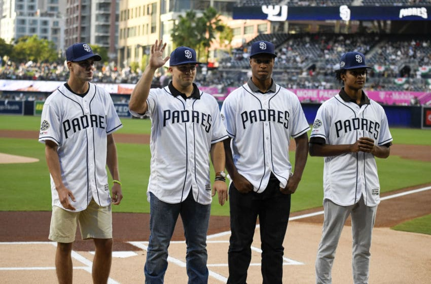 SAN DIEGO, CA - JUNE 8: San Diego Padres draft picks, from left, Matt Brash, Logan Driscoll, Joshua Mears and C.J Abrams, stand at home plate before a baseball game between the San Diego Padres and the Washington Nationals at Petco Park June 8, 2019 in San Diego, California. (Photo by Denis Poroy/Getty Images)