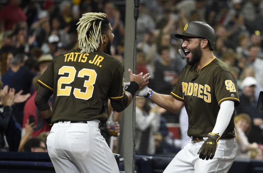 SAN DIEGO, CA - JUNE 28: Eric Hosmer #30 of the San Diego Padres, right, is congratulated by Fernando Tatis Jr. #23 after hitting a solo home run during the sixth inning of a baseball game against the St. Louis Cardinals at Petco Park June 28, 2019 in San Diego, California. (Photo by Denis Poroy/Getty Images)
