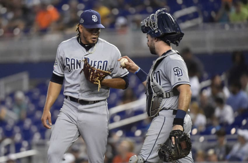 MIAMI, FL - JULY 18: Catcher Austin Hedges #18 of the San Diego Padres talks to pitcher Dinelson Lamet #29 between pitches during the game against the Miami Marlins at Marlins Park on July 18, 2019 in Miami, Florida. (Photo by Eric Espada/Getty Images)