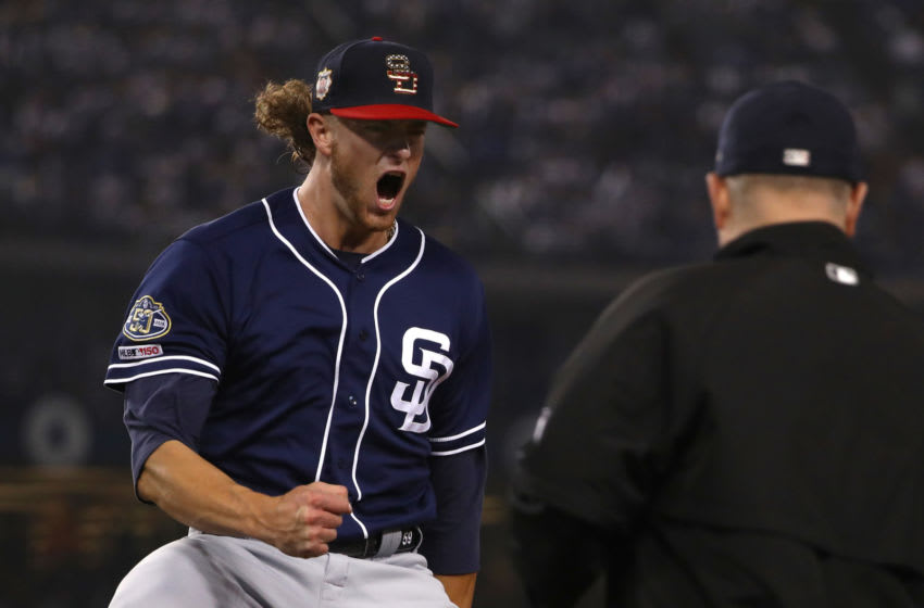 LOS ANGELES, CALIFORNIA - JULY 06: Pitcher Chris Paddack #59 of the San Diego Padres reacts after getting the force out at first base with the bases loaded to end the fifth inning of the MLB game against the Los Angeles Dodgers during the MLB game at Dodger Stadium on July 06, 2019 in Los Angeles, California. (Photo by Victor Decolongon/Getty Images)