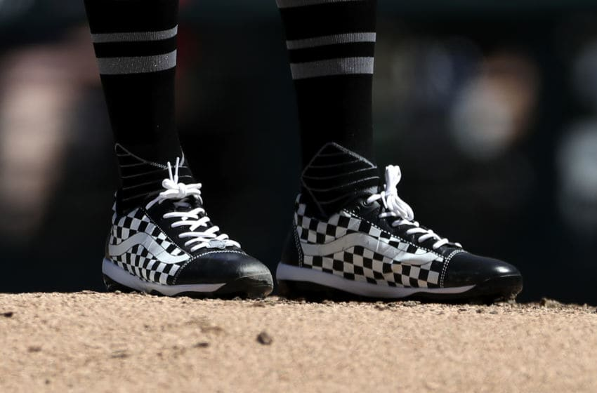 CLEVELAND, OH - AUGUST 25: Detail view of cleats worn by starting pitcher Shane Bieber #57 of the Cleveland Indians as he stands on the mound during the second inning against the Kansas City Royals at Progressive Field on August 25, 2019 in Cleveland, Ohio. Teams are wearing special color schemed uniforms with players choosing nicknames to display for Players' Weekend. (Photo by Ron Schwane/Getty Images)