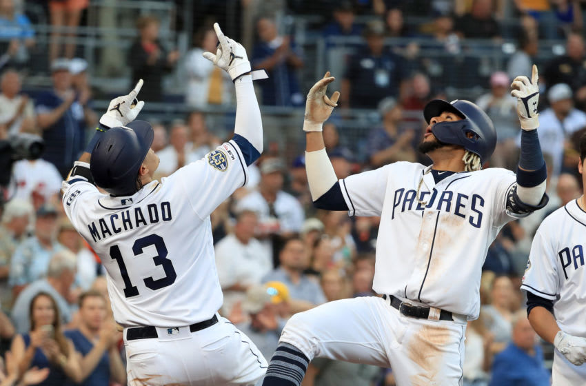 SAN DIEGO, CALIFORNIA - JULY 27: Manny Machado #13 congratulates Fernando Tatis Jr. #23 after his two-run home run by Fernando Tatis Jr. #23 during the fifth inning of a game against the San Francisco Giants at PETCO Park on July 27, 2019 in San Diego, California. (Photo by Sean M. Haffey/Getty Images)