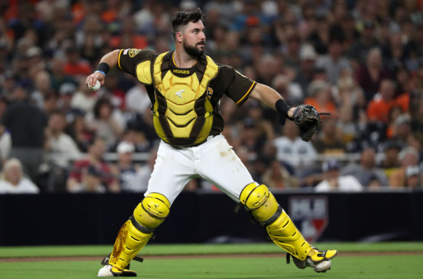 SAN DIEGO, CALIFORNIA - JULY 26: Austin Hedges #18 of the San Diego Padres fields an infield single hit by Tyler Austin #19 of the San Francisco Giants during the fifth inning of a game at PETCO Park on July 26, 2019 in San Diego, California. (Photo by Sean M. Haffey/Getty Images)