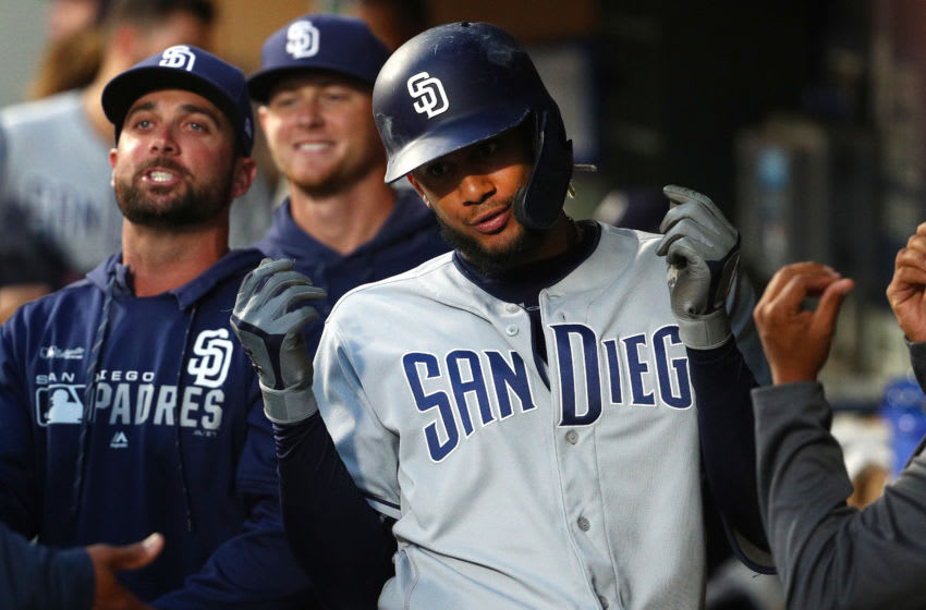 SEATTLE, WASHINGTON - AUGUST 06: Fernando Tatis Jr. #23 of the San Diego Padres celebrates in the dugout after hitting a two run home run against the Seattle Mariners in the fifth inning during their game at T-Mobile Park on August 06, 2019 in Seattle, Washington. (Photo by Abbie Parr/Getty Images)