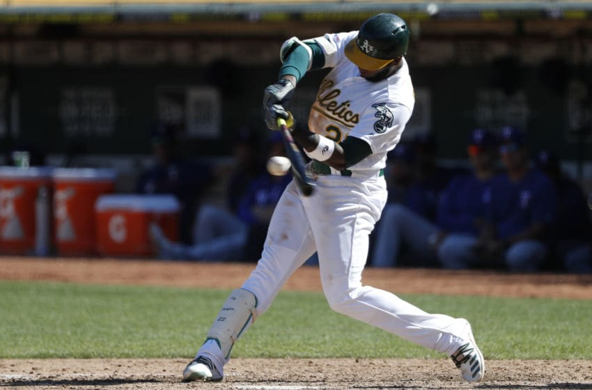 OAKLAND, CA - SEPTEMBER 22: Jurickson Profar #23 of the Oakland Athletics connects for a single during the sixth inning against the Texas Rangers at Ring Central Coliseum on September 22, 2019 in Oakland, California. The Rangers defeated the Athletics 8-3. (Photo by Stephen Lam/Getty Images)