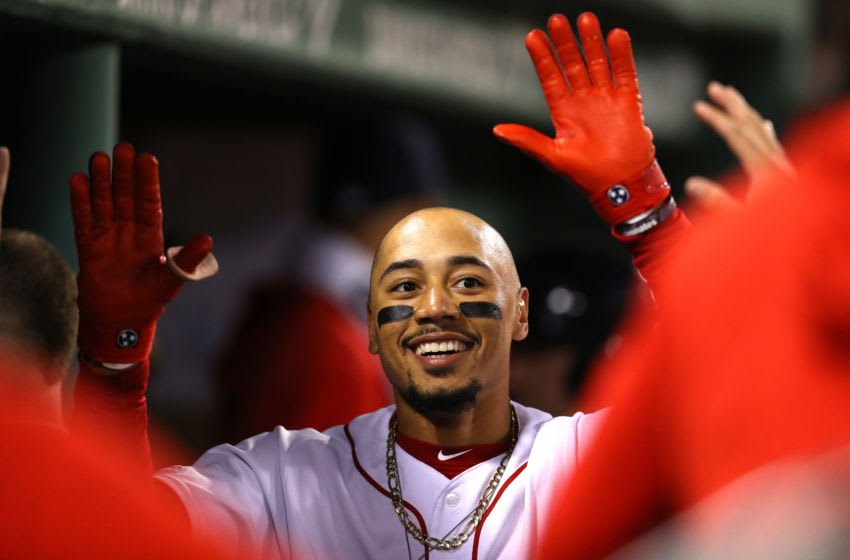 BOSTON, MASSACHUSETTS - SEPTEMBER 05: Mookie Betts #50 of the Boston Red Sox celebrates with teammates in the dugout after hitting a home run against the Minnesota Twins during the fourth inning at Fenway Park on September 05, 2019 in Boston, Massachusetts. (Photo by Maddie Meyer/Getty Images)