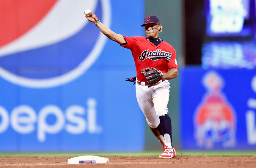CLEVELAND, OHIO - SEPTEMBER 20: Shortstop Francisco Lindor #12 of the Cleveland Indians throws out Maikel Franco #7 of the Philadelphia Phillies at first during the third inning at Progressive Field on September 20, 2019 in Cleveland, Ohio. (Photo by Jason Miller/Getty Images)