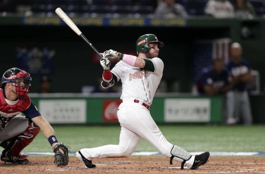 TOKYO, JAPAN - NOVEMBER 17: Infielder Esteban Quiroz #8 of Mexico grounds out in the bottom of 4th inning during the WBSC Premier 12 Bronze Medal final game between Mexico and USA at the Tokyo Dome on November 17, 2019 in Tokyo, Japan. (Photo by Kiyoshi Ota/Getty Images)