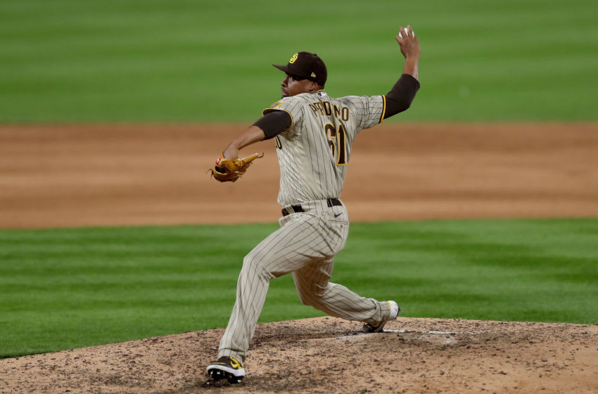 DENVER, COLORADO - AUGUST 01: Pitcher Luis Perdomo #61 of the San Diego Padres throws in the eighth inning against the Colorado Rockies at Coors Field on August 01, 2020 in Denver, Colorado. (Photo by Matthew Stockman/Getty Images)