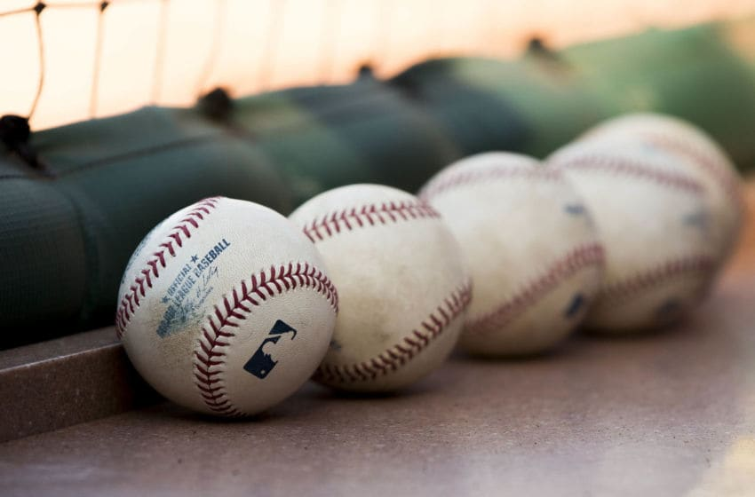 ST. LOUIS, MO - APRIL 25: Baseballs sit in the St. Louis Cardinals dugout prior to a game between the Pittsburgh Pirates and the St. Louis Cardinals at Busch Stadium on April 25, 2014 in St. Louis, Missouri. (Photo by David Welker/Getty Images)