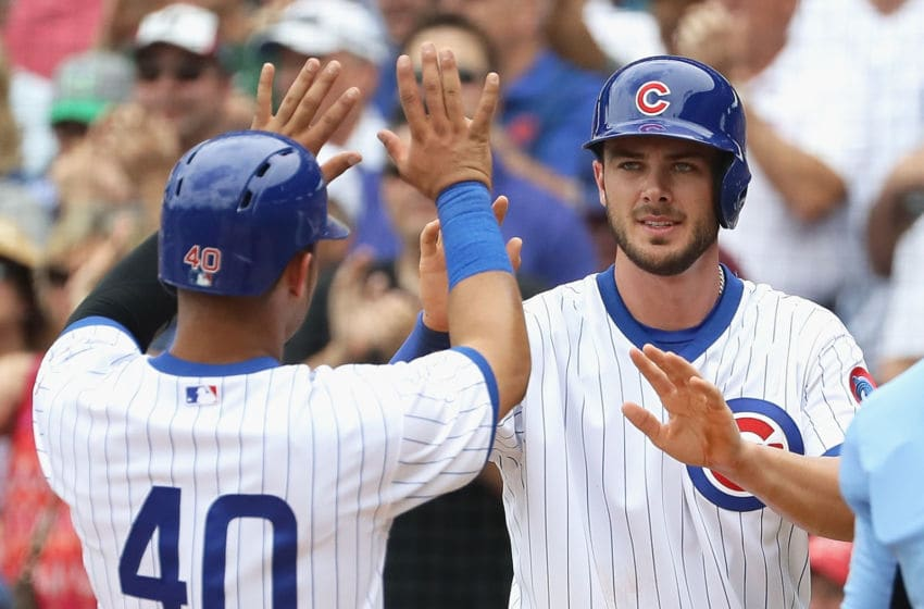 CHICAGO, IL - JULY 20: Kris Bryant #17 of the Chicago Cubs greets Willson Contreras #40 after they scored runs in the 1st inning against the New York Mets at Wrigley Field on July 20, 2016 in Chicago, Illinois. (Photo by Jonathan Daniel/Getty Images)