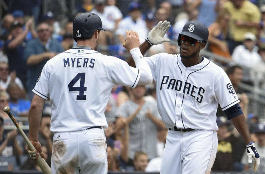 SAN DIEGO, CA - MAY 31: Franchy Cordero #33 of the San Diego Padres is congratulated by Wil Myers #4 of the San Diego Padres after scoring during the eighth inning of a baseball game against the Chicago Cubs at PETCO Park on May 31, 2017 in San Diego, California. (Photo by Denis Poroy/Getty Images)
