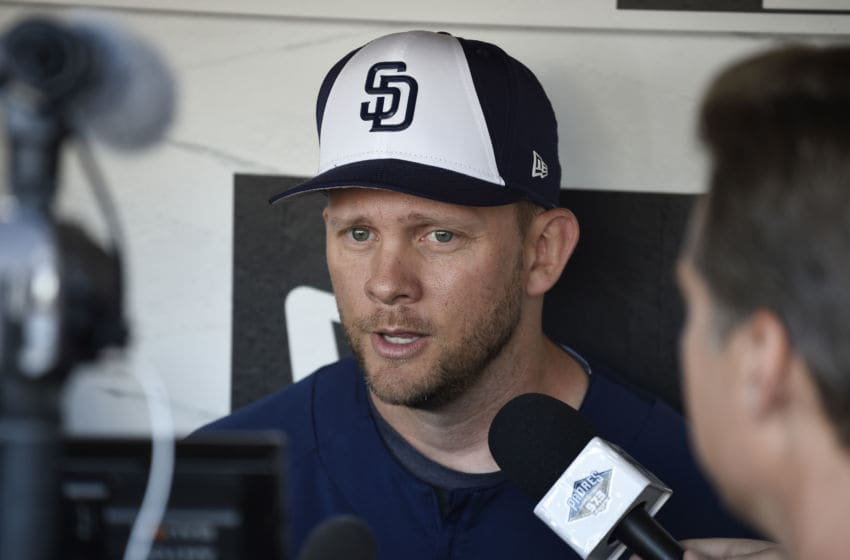 SAN DIEGO, CA - MARCH 29: Manager Andy Green of the San Diego Padres answers questions in the dugout during batting practice before Opening Day against the Milwaukee Brewers at PETCO Park on March 29, 2018 in San Diego, California. (Photo by Denis Poroy/Getty Images)