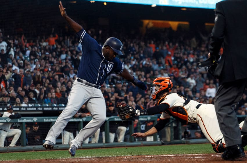SAN FRANCISCO, CA - JUNE 21: Jose Pirela #2 of the San Diego Padres is tagged out at home plate by Buster Posey #28 of the San Francisco Giants during the fifth inning at AT&T Park on June 21, 2018 in San Francisco, California. The San Francisco Giants defeated the San Diego Padres 3-0. (Photo by Jason O. Watson/Getty Images)