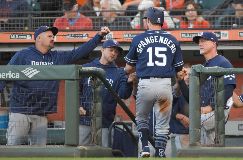 SAN FRANCISCO, CA - JUNE 22: Cory Spangenberg #15 of the San Diego Padres is congratulated by (L-R) David Wells, manager Andy Green #14 and coach Mark McGwire #25 after Spangenberg scored against the San Francisco Giants in the top of the second inning at AT&T Park on June 22, 2018 in San Francisco, California. (Photo by Thearon W. Henderson/Getty Images)