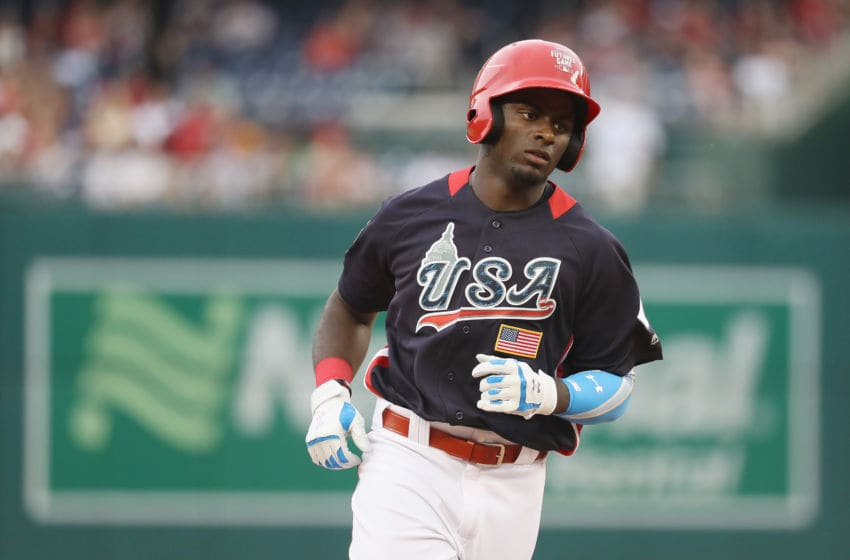 WASHINGTON, DC - JULY 15: Taylor Trammell #5 of the Cincinnati Reds and the U.S. Team rounds the bases after hitting a solo home run in the sixth inning against the World Team during the SiriusXM All-Star Futures Game at Nationals Park on July 15, 2018 in Washington, DC. (Photo by Rob Carr/Getty Images)