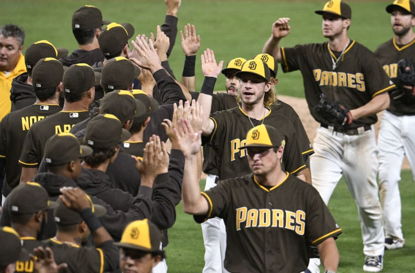 SAN DIEGO, CALIFORNIA - SEPTEMBER 23: San Diego Padres players celebrate after beating the San Francisco Giants 7-2 in a baseball game at PETCO Park on September 23, 2016 in San Diego, California. (Photo by Denis Poroy/Getty Images)