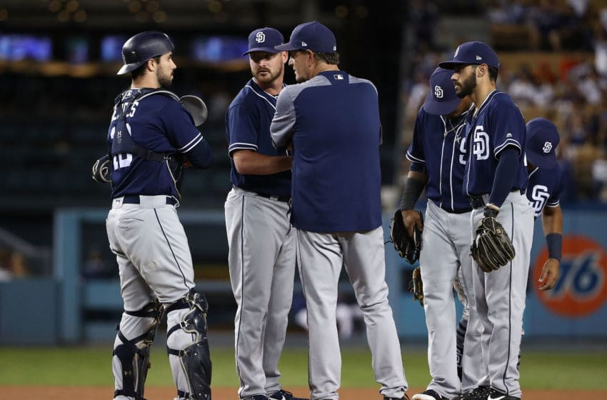 LOS ANGELES, CA - SEPTEMBER 25: Pitching coach Darren Balsley of the San Diego Padres talks to catcher Austin Hedges