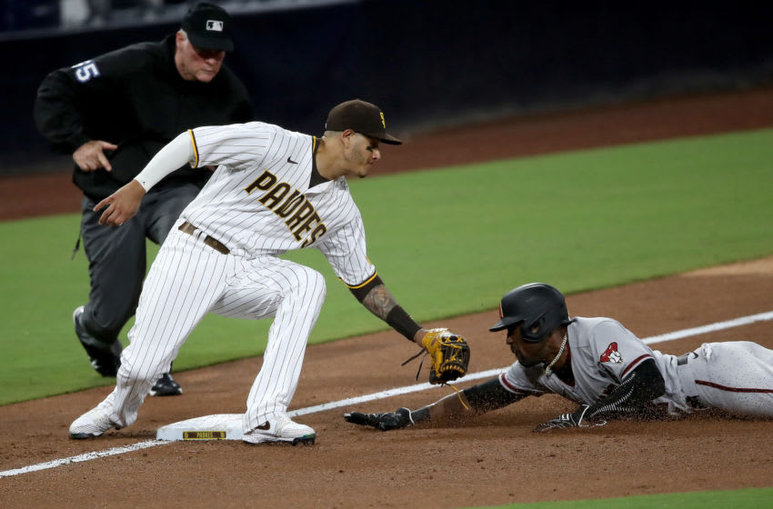 SAN DIEGO, CALIFORNIA - JULY 25: Ketel Marte #4 of the Arizona Diamondbacks is tagged out by Manny Machado #13 of the San Diego Padres stealing third base during the fifth inning of a game at PETCO Park on July 25, 2020 in San Diego, California. (Photo by Sean M. Haffey/Getty Images)
