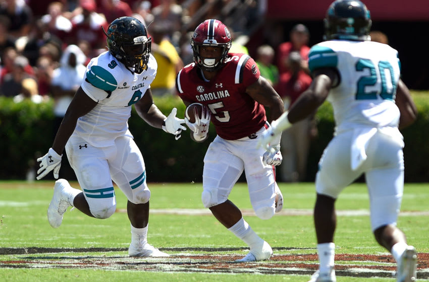 COLUMBIA, SC - SEPTEMBER 01: Rico Dowdle #5 of the South Carolina Gamecocks runs with the ball against Tarron Jackson #9 of the Coastal Carolina Chanticleers at Williams-Brice Stadium on September 1, 2018 in Columbia, South Carolina. SC won 49-15. (Photo by Lance King/Getty Images)