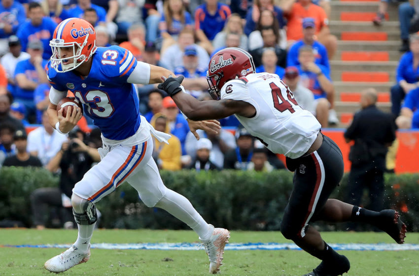 GAINESVILLE, FLORIDA - NOVEMBER 10: Feleipe Franks #13 of the Florida Gators attempts to run past Sherrod Greene #44 of the South Carolina Gamecocks during the game at Ben Hill Griffin Stadium on November 10, 2018 in Gainesville, Florida. (Photo by Sam Greenwood/Getty Images)