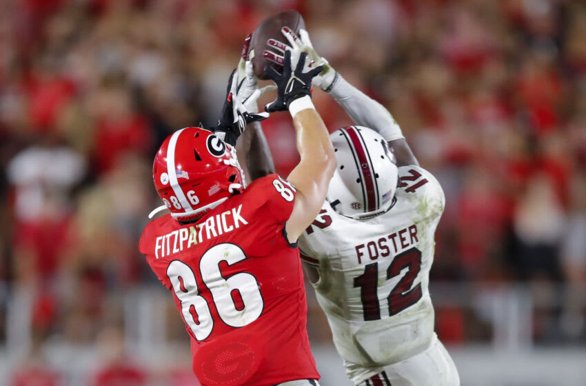 ATHENS, GA - SEPTEMBER 18: Jaylan Foster #12 of the South Carolina Gamecocks makes an interception over John FitzPatrick #86 of the Georgia Bulldogs in the second half at Sanford Stadium on September 18, 2021 in Athens, Georgia. (Photo by Todd Kirkland/Getty Images)