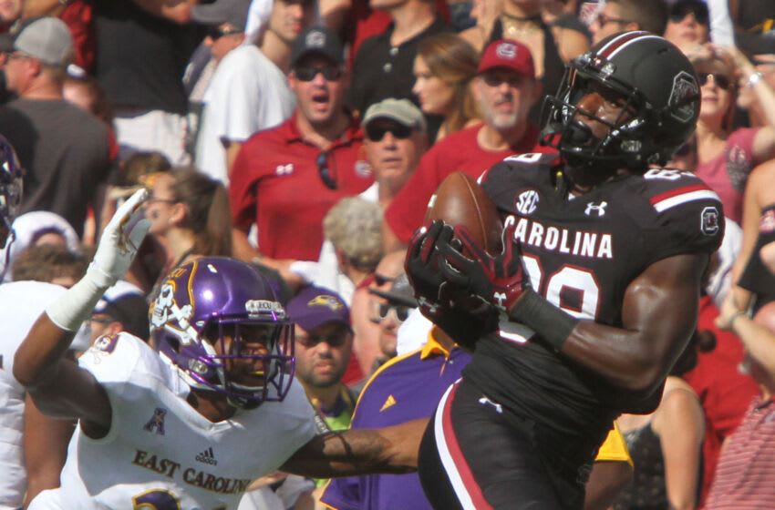 COLUMBIA,SC - SEPTEMBER 17: Receiver Bryan Edwards #89 of the South Carolina Gamecocks makes the catch as Cornerback Colby Gore #26 of the East Carolina Pirates tries to cover during the first quarter at Williams-Brice Stadium on September 17, 2016 in Columbia, South Carolina. (Photo by Mary Ann Chastain/ Getty Images)