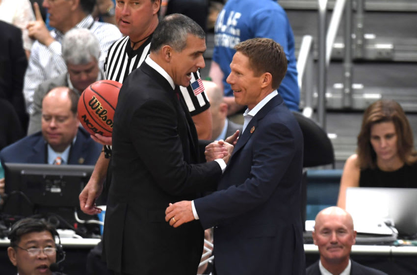 Head coach Frank Martin (L) of the South Carolina Gamecocks talks with head coach Mark Few of the Gonzaga Bulldogs. (Photo by Lance King/Getty Images)