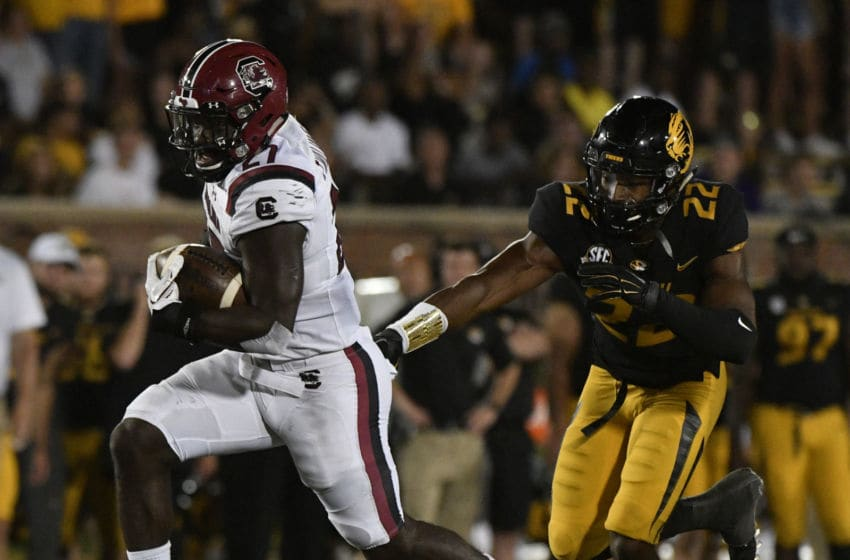 COLUMBIA, MO - SEPTEMBER 9: Running back Ty'Son Williams #27 of the South Carolina Gamecocks runs past defensive back Anthony Sherrils #22 of the Missouri Tigers for a first down in the fourth quarter at Memorial Stadium on September 9, 2017 in Columbia, Missouri. (Photo by Ed Zurga/Getty Images)