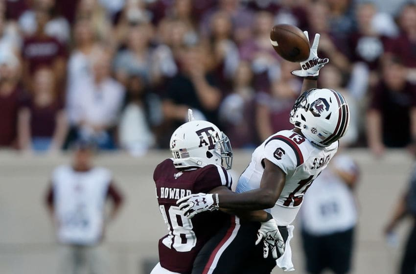 COLLEGE STATION, TX - SEPTEMBER 30: Shi Smith #13 of the South Carolina Gamecocks attempts but is unable to make a one handed catch as Antonio Howard #18 of the Texas A&M Aggies defends at Kyle Field on September 30, 2017 in College Station, Texas. (Photo by Bob Levey/Getty Images)