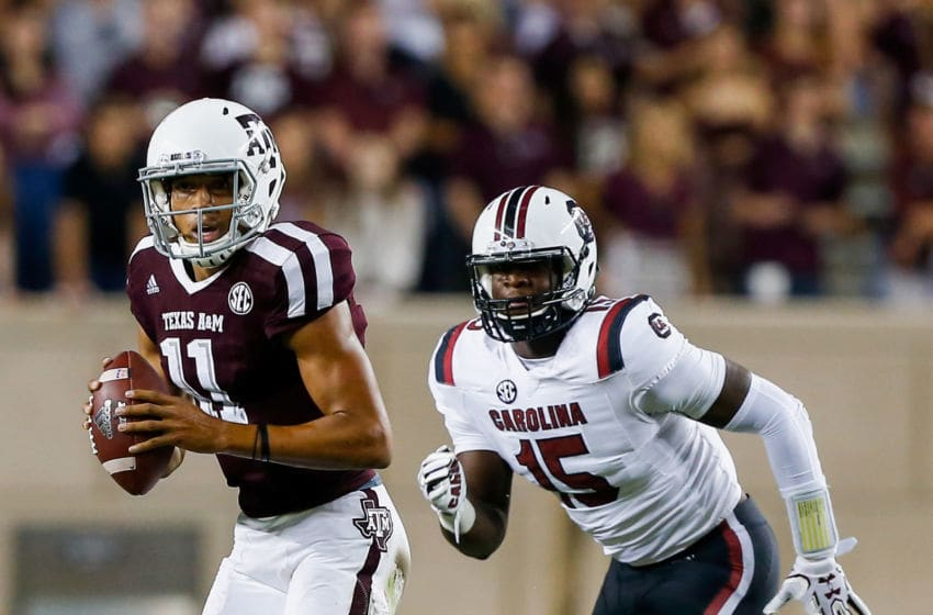 Kellen Mond #11 of the Texas A&M Aggies runs from Aaron Sterling #15 of the South Carolina Gamecocks. (Photo by Bob Levey/Getty Images)
